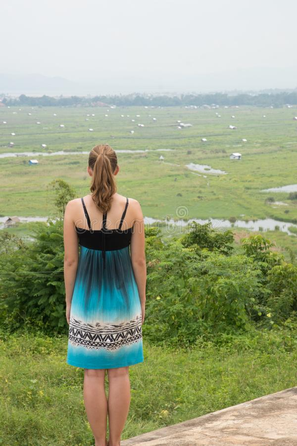 Young woman overlooking inle lake area in central myanmar stock photography