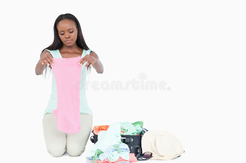 Young Woman Packing Her Trunk Stock Photo