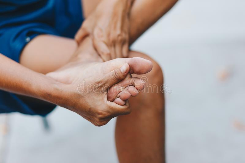 Young woman pain in her foot royalty free stock image