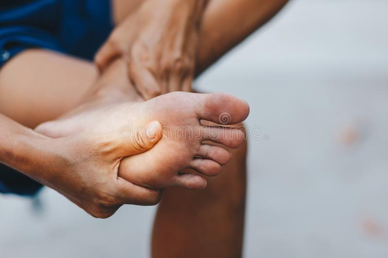 Young woman pain in her foot stock images