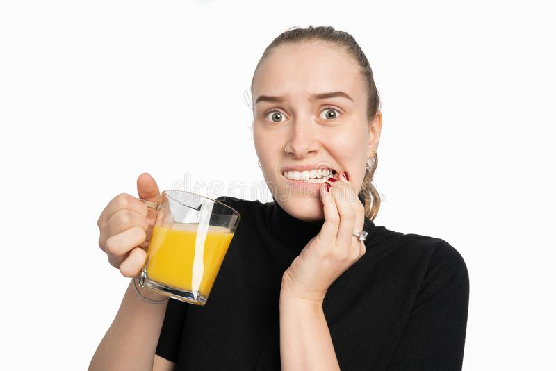 Young woman is pain sensitive when drinking cold drinks stock images