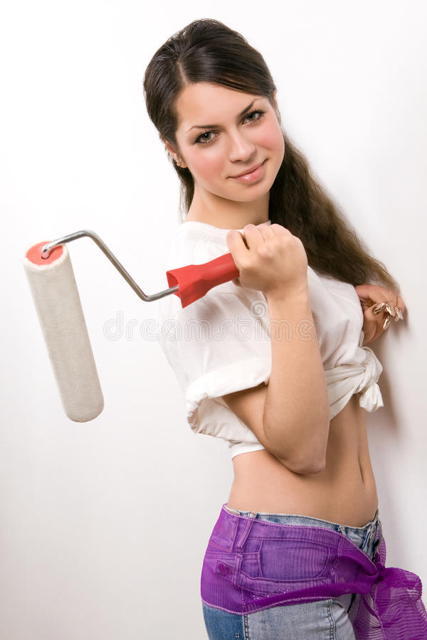 Download Young Woman With Painting Roller Stock Photo - Image: 11199178