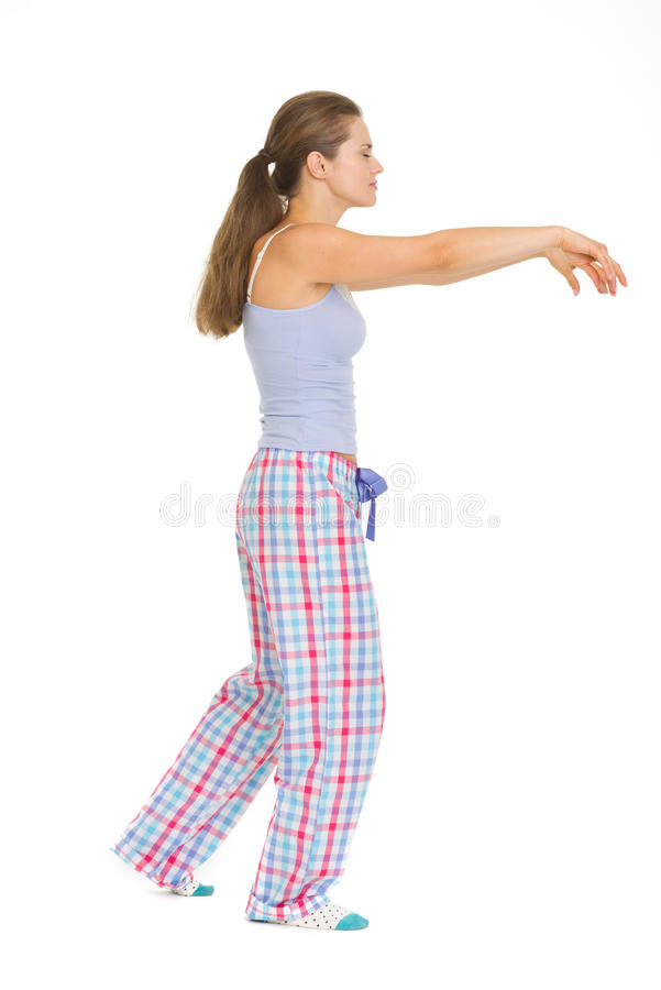 Young Woman In Pajamas Sleep Walking Royalty Free Stock Images