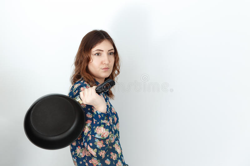 Young woman with pan on white background stock photo