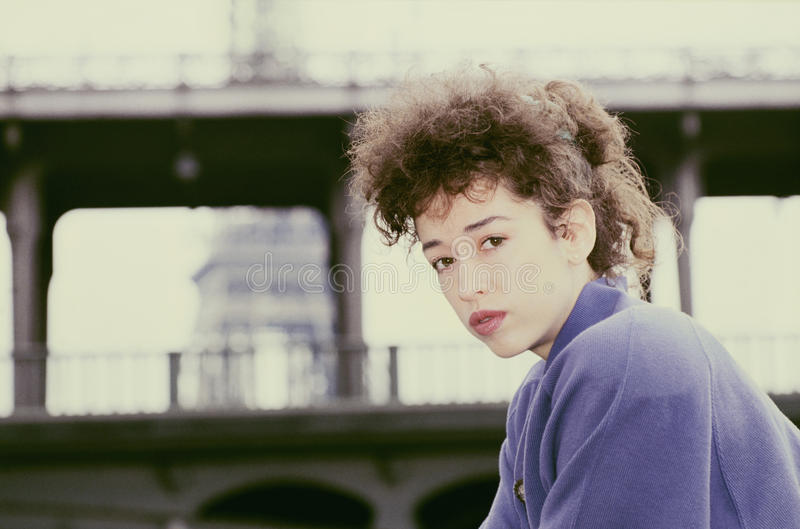 Young woman in Paris 80s look Brige and Eiffel tower stock photos