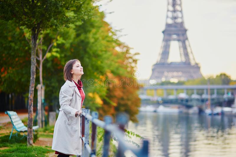 Young woman in Paris near the Eiffel tower royalty free stock photo