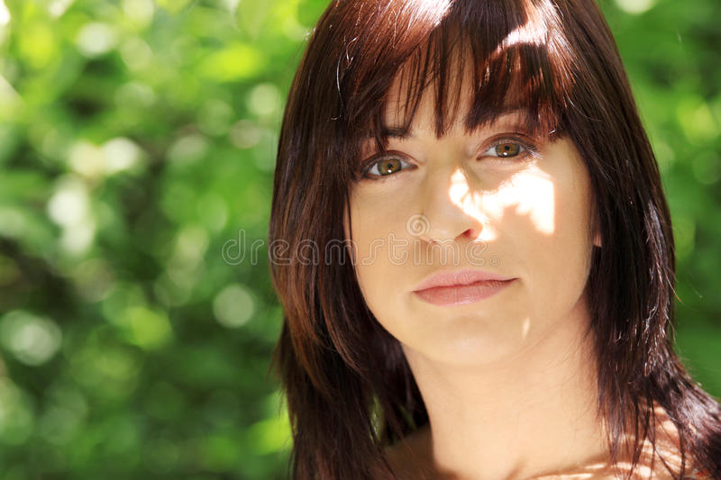 Young woman in park stock photos