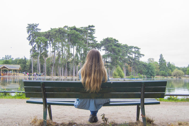Young woman in a park in Paris stock image