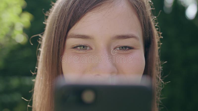 Young Woman in the Park Using a Phone stock photo