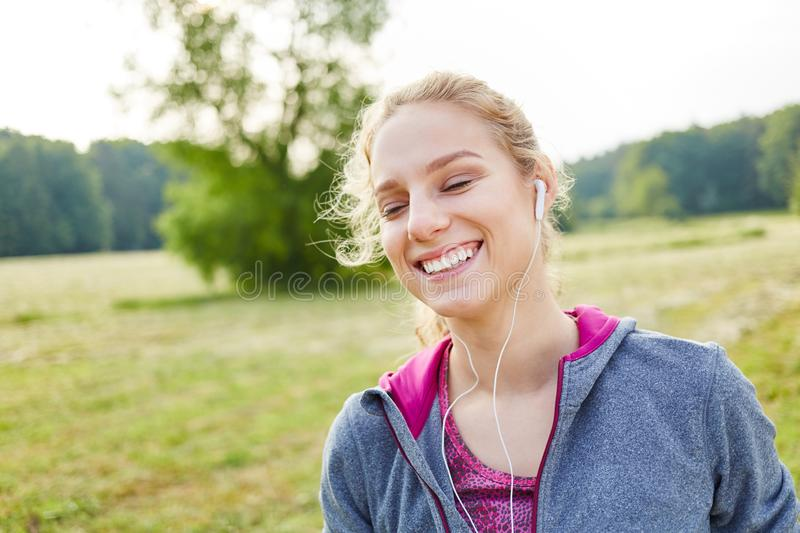 Young woman at the park royalty free stock image