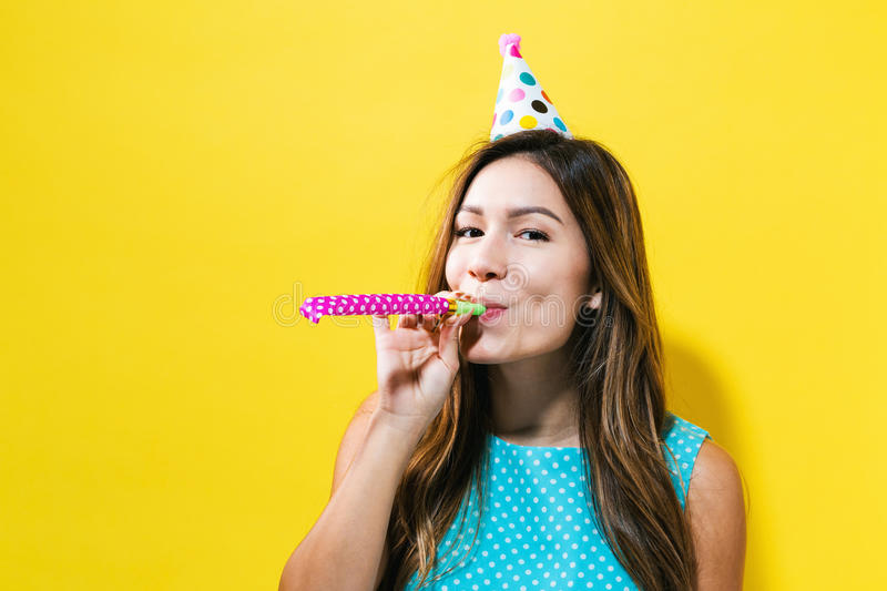 Young woman with party hat with noisemaker royalty free stock photo