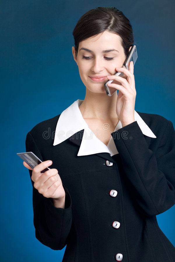 Download Young Woman Paying With Credit Card By Phone Royalty Free Stock Image - Image: 1658406