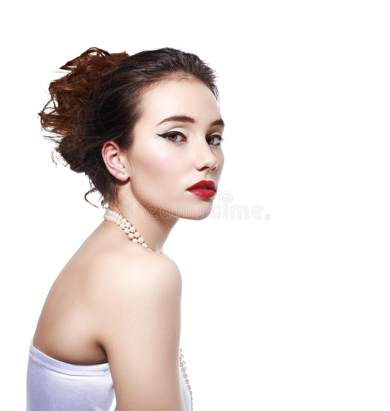 Young woman with pearl necklace royalty free stock image