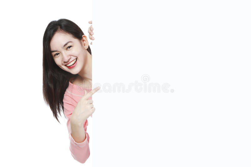 Young Woman Peeking royalty free stock photography