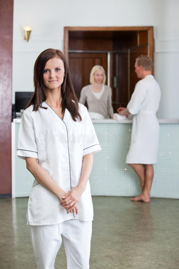 Young Woman With People In Background At Spa Stock Photos