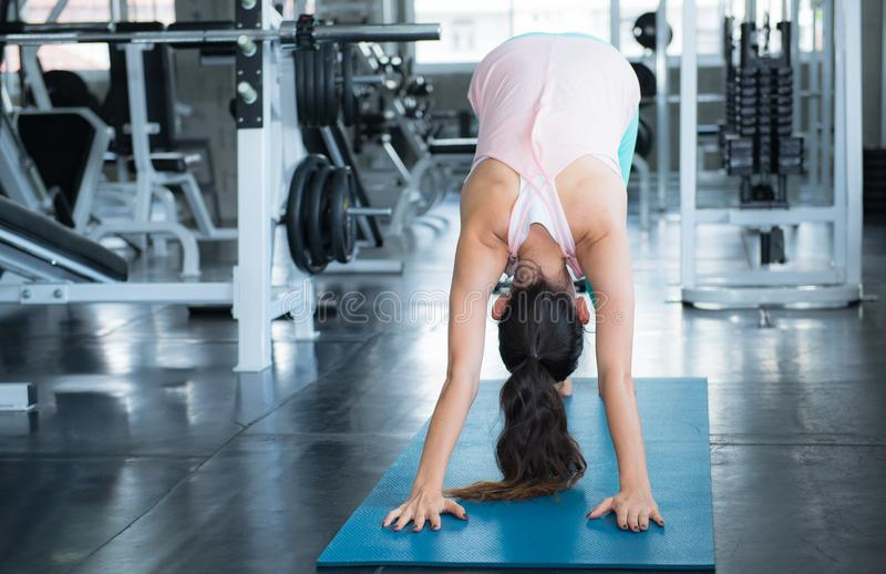 A young woman perform yoga activity in the gym stock images