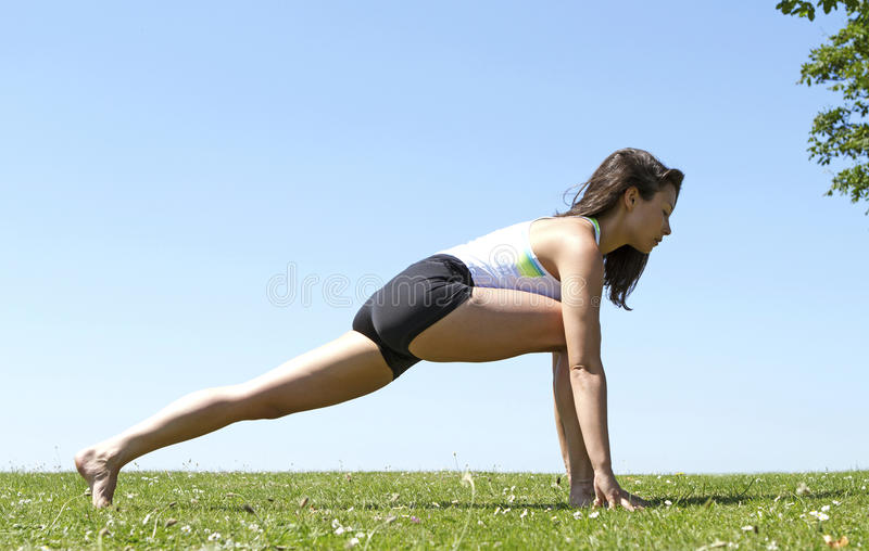 Young Woman Performing a Lunge stock photos