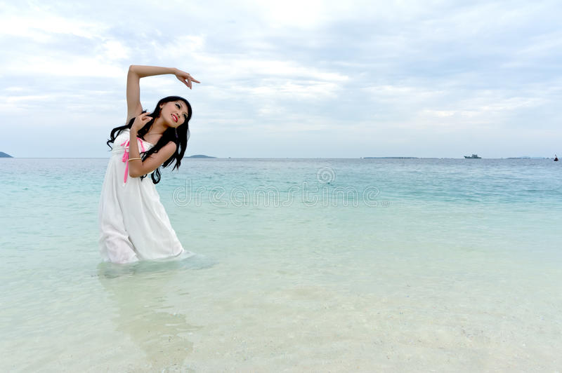 Download Young Woman Performs Tropical Island Stock Image - Image: 19486173