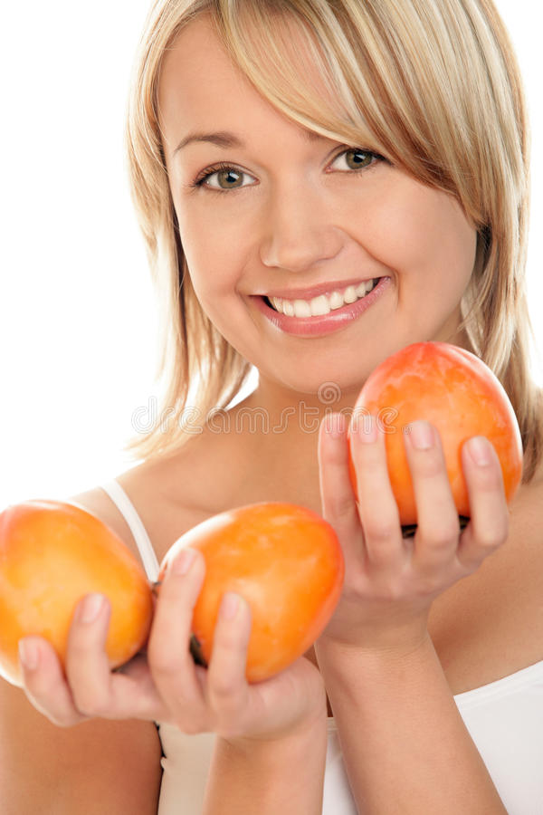 Young woman with persimmons. stock photo