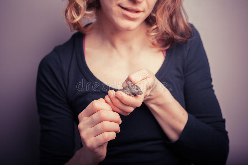 Young woman with pet mouse royalty free stock photos