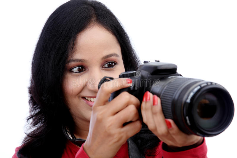 Young woman photographer. Portrait of young woman photographer shooting images stock image
