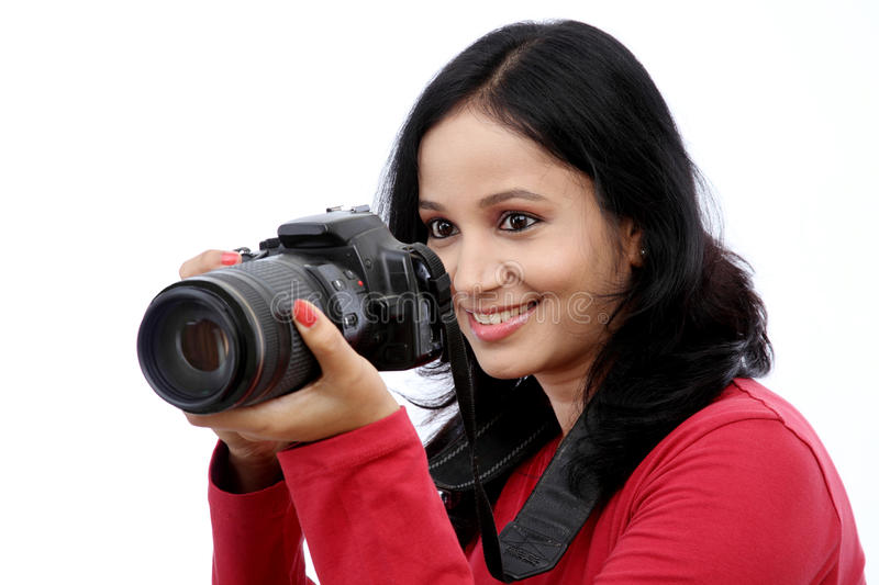 Young woman photographer. Taking images stock photo