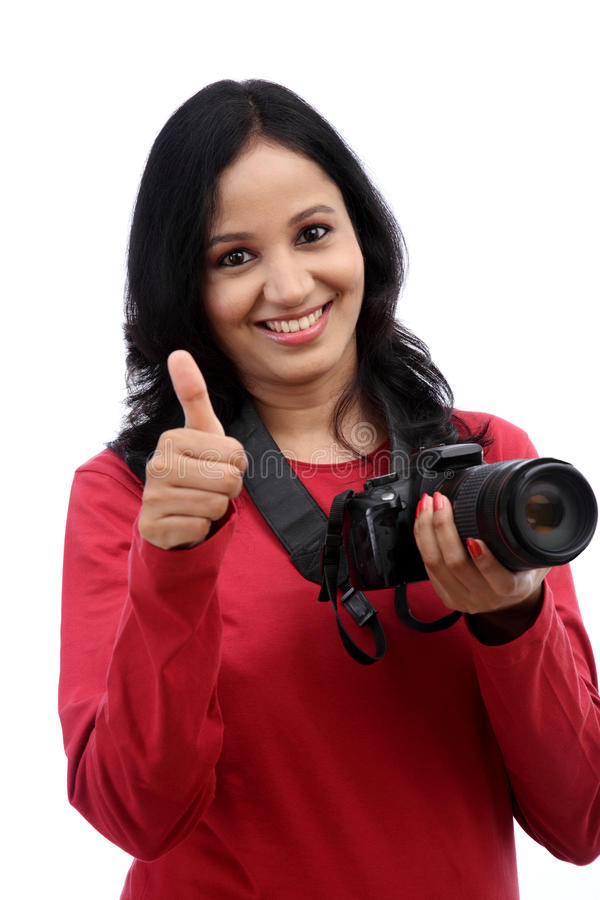 Young woman photographer. Taking images stock images