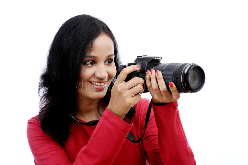 Young woman photographer taking images. Portrait of young woman photographer taking images royalty free stock image