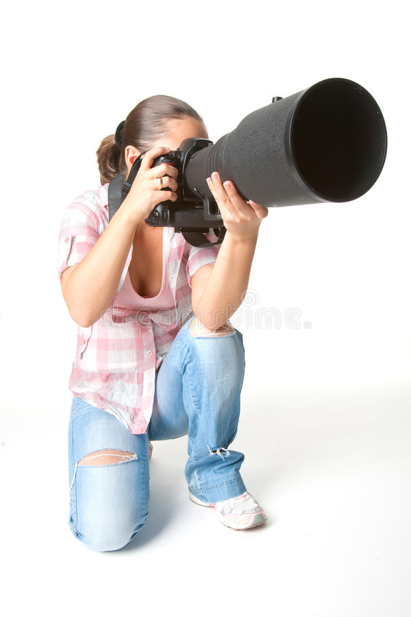 Young woman photographer at work stock image