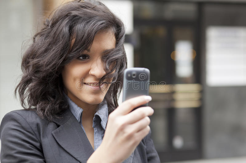 Young Woman photographing with cell phone royalty free stock photo