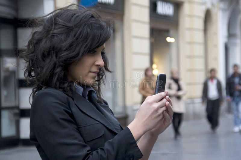 Young Woman photographing with cell phone stock image