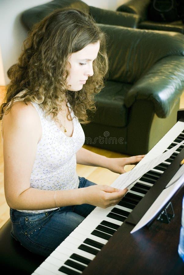 Young Woman at Piano stock photo