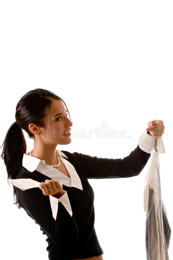 Young woman picking up her dry cleaning. royalty free stock images