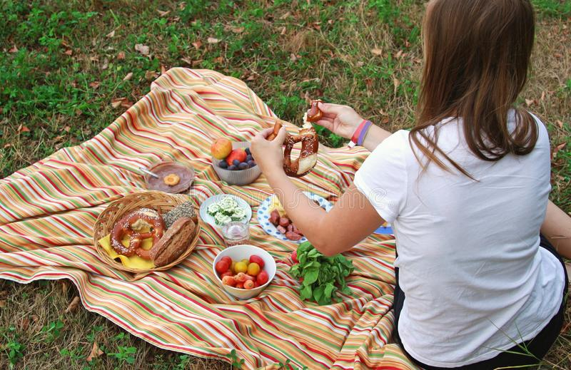 Young woman at a picnic on a meadow stock images