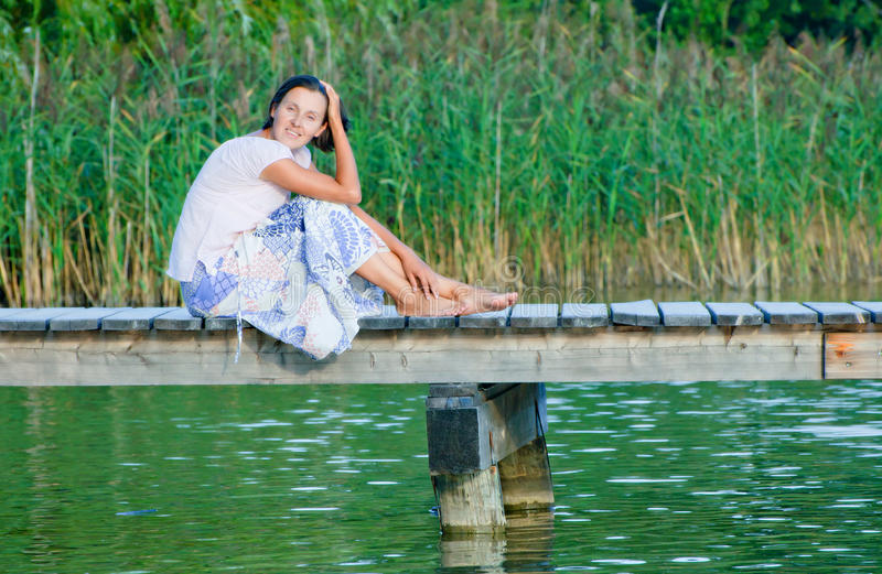 Download Young Woman On Pier stock photo. Image of cute, leisure - 19465364