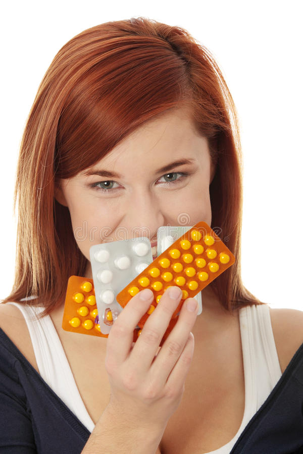 Download Young woman with pills stock photo. Image of life, happy - 16627778