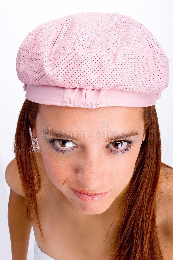 Young woman in pink cap royalty free stock photo