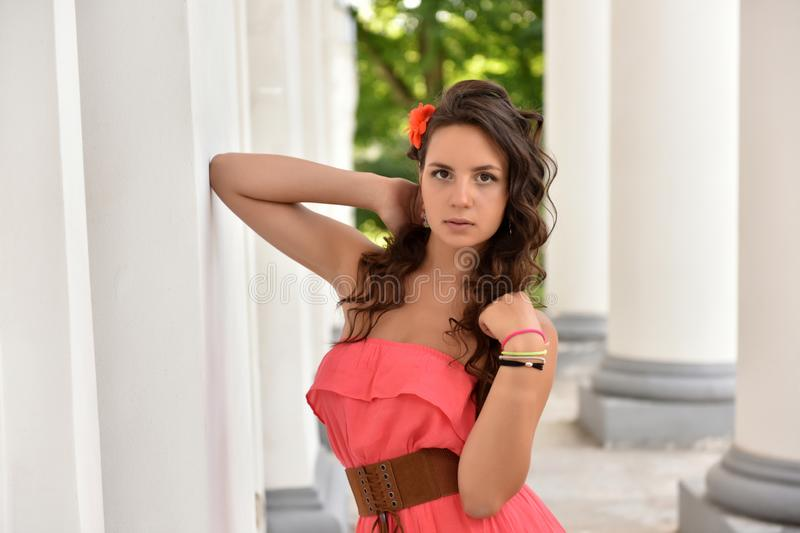 Young woman in pink fashionable dress royalty free stock photos
