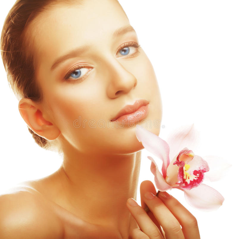 Young woman with pink orchid royalty free stock photos