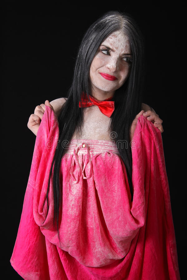 Young woman in a pink skirt covered with a white powder royalty free stock photography