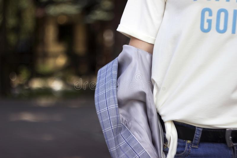 Young woman in plaid jacket, white t-shirt and jeans, street style, fashion.  royalty free stock images