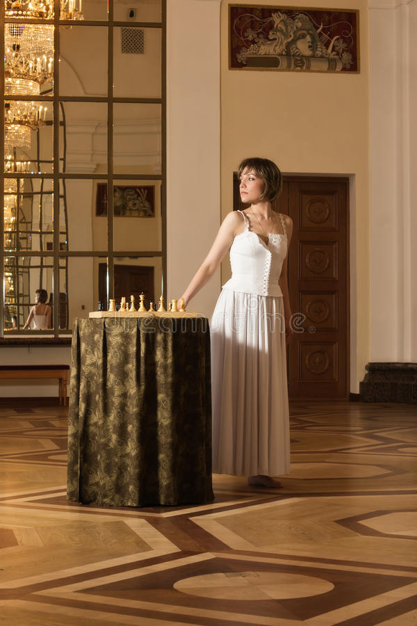Download Young  Woman Play Chess In The Rich Interior Stock Image - Image: 20107305