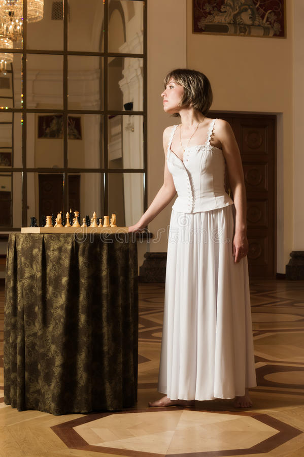 Download Young  Woman Play Chess In The Rich Interior Stock Image - Image: 20107321