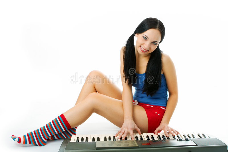 Young woman play piano. On white background royalty free stock image