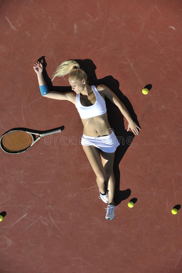 Young woman play tennis outdoor royalty free stock photos