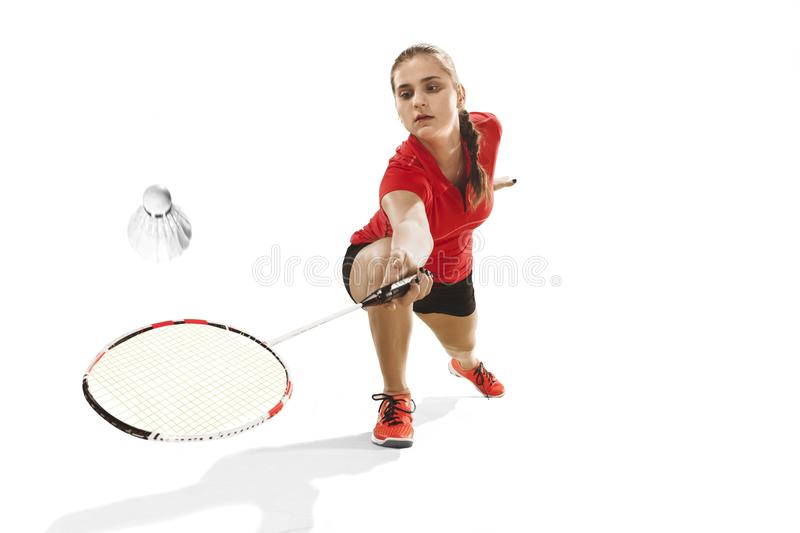 Young woman playing badminton over white background royalty free stock images