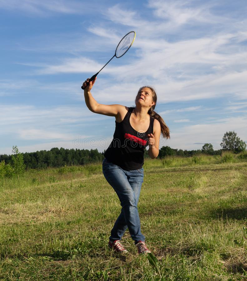 Young woman playing badminton royalty free stock photo
