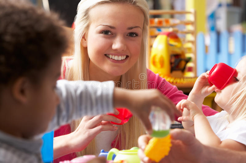Download Young Woman Playing With Boy Stock Photo - Image: 19686208