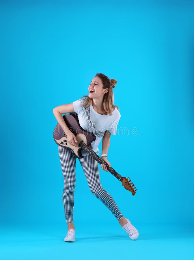 Young woman playing electric guitar stock photos