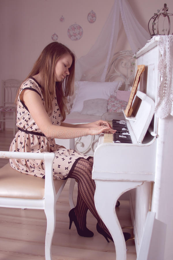 Download Young Woman Playing The Piano Stock Image - Image of grand, female: 30724969